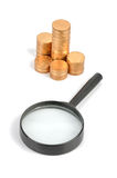 Magnifier glass and coins Royalty Free Stock Image