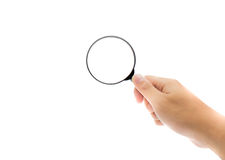 hand holding Magnifier glass in isolated  background Stock Photos