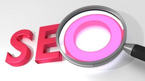 Magnifier glass SEO search engine optimization concept Stock Photos