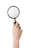 Magnifier glass in woman hand isolated on white Royalty Free Stock Photos
