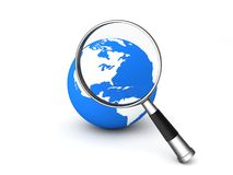 Magnifier on globe Stock Photos