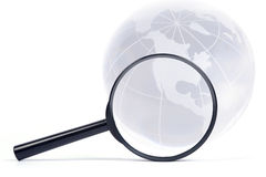 Magnifier and globe. Stock Photography