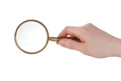 Magnifier in hand Royalty Free Stock Photos