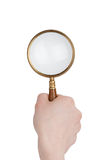 Magnifier in hand Royalty Free Stock Photo