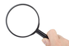 Magnifier in hand stock photos