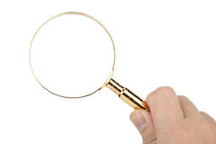 Magnifier in hand Stock Images