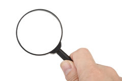Magnifier in hand Royalty Free Stock Image