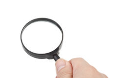 Magnifier in hand Stock Photography