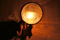 Magnifying glass on the light bulb royalty free stock image