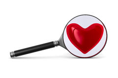 Magnifier and heart on white background Royalty Free Stock Photography