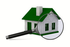 Magnifier and house on white background Royalty Free Stock Images