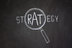Magnifier i słowo 'strategii' Fotografia Royalty Free