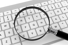 Magnifier with keyboard Royalty Free Stock Photos