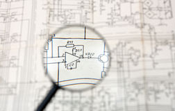Magnifier lens. And circuit diagram Stock Images