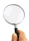 Magnifier Lens. Hand holding a magnifier lens isolated in a white background Stock Photography