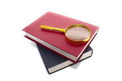 Magnifier lens and pile of books. This is magnifier lens and pile of books. It is theme of education Stock Photos