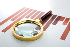 Magnifier lies on the printed diagram Royalty Free Stock Image