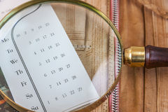 Magnifier Lying On The Calendar. Close Up Royalty Free Stock Photography