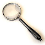 Magnifier lying on the surface. Royalty Free Stock Images