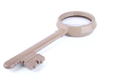 The magnifier made as a key Royalty Free Stock Images