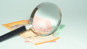 Magnifier with Malaysia bank notes.concept photo. Magnifier with Malaysia bank notes Stock Photos
