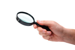 Magnifier in man hand Stock Photos