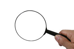 Magnifier in man hand isolated on white background. Stock Photography