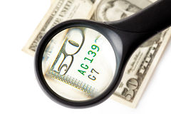 Magnifier and money Royalty Free Stock Photo