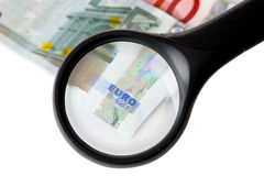 Magnifier and money Stock Photo