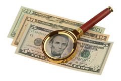 Magnifier and money Royalty Free Stock Images