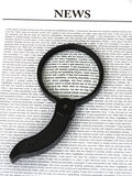 Magnifier on News Stock Photo