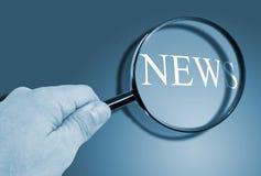 Magnifier news Stock Photos