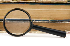 Magnifier and old books Royalty Free Stock Photo