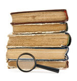 Magnifier and old books Royalty Free Stock Photography