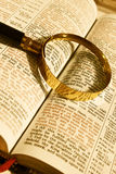 Magnifier on the open Bible Stock Image