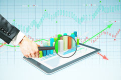 Magnifier over tablet with chart Royalty Free Stock Photo