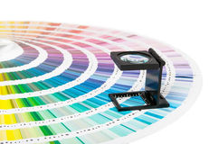 Magnifier and pantone guide Stock Images