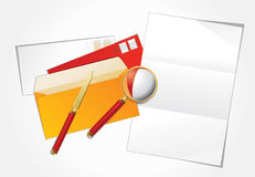 Magnifier, paper knife and layout letter. Royalty Free Stock Photography