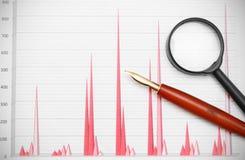 Magnifier and pen Stock Photos