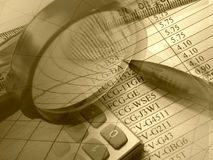 Magnifier, pen, ruler and calculator Stock Image