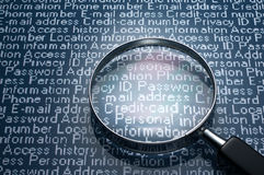 Magnifier and personal information. Stock Images