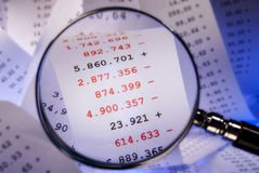 Magnifier and red numbers stock photography