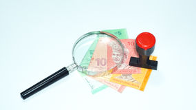 Magnifier and rubber stamp with Malaysia bank notes.concept photo. Magnifier with Malaysia bank notes Stock Photos
