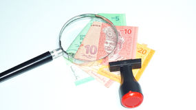 Magnifier and rubber stamp with Malaysia bank notes.concept photo. Magnifier with Malaysia bank notes Royalty Free Stock Photo