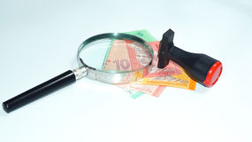 Magnifier and rubber stamp with Malaysia bank notes.concept photo. Magnifier with Malaysia bank notes Stock Photo