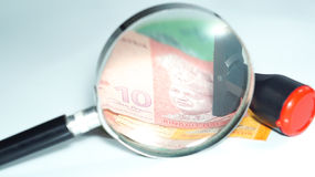 Magnifier and rubber stamp with Malaysia bank notes.concept photo. Magnifier with Malaysia bank notes Stock Images