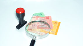 Magnifier and rubber stamp with Malaysia bank notes.concept photo. Magnifier with Malaysia bank notes Royalty Free Stock Photography