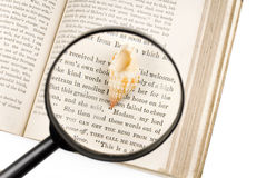 Magnifier and Seashell. Seashells, magnifier, and old book on the white background Stock Photography