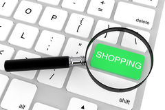 Magnifier with Shopping key Royalty Free Stock Image