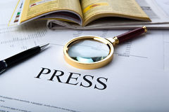 Magnifier and sign the press Royalty Free Stock Photos